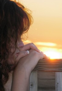 Young Girl Staring Off Into The Sunset