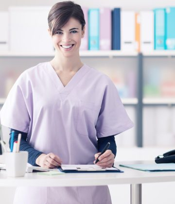 Nurse Smiling At Her Desk
